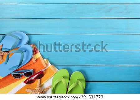 Beach background border, flip flops, sunglasses, copy space - stock photo