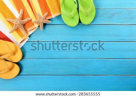 Beach background, starfish, flip flops, copy space - stock photo