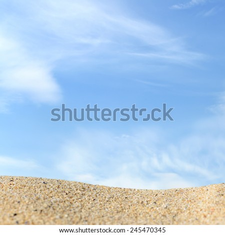 Beach background with a bunch of sand on a background of sky. Ready for product display montage - stock photo