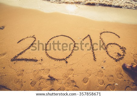 beach background with 2016 new year written on sand - stock photo
