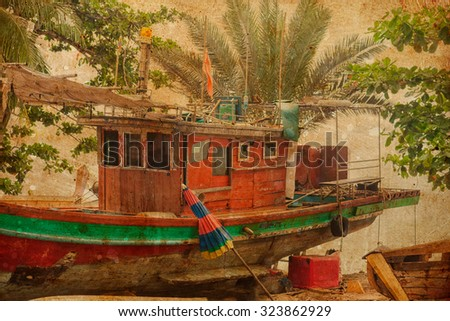 beach background with palm and old boat - stock photo