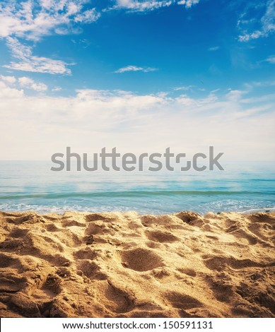 Beach background with sand, ocean and sky - stock photo
