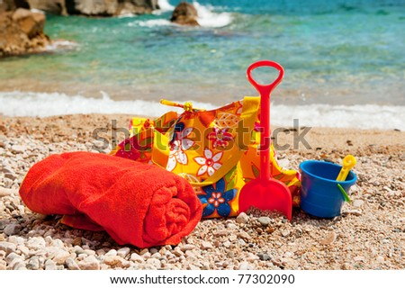 Beach bag, towel and plastic toys for vacation