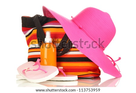 Beach bag with accessories isolated on white - stock photo