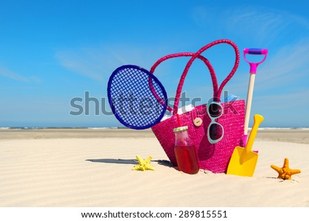Beach bag with luggage and toys for the whole family - stock photo