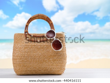 Beach bag with sunglasses ready for the beach - stock photo