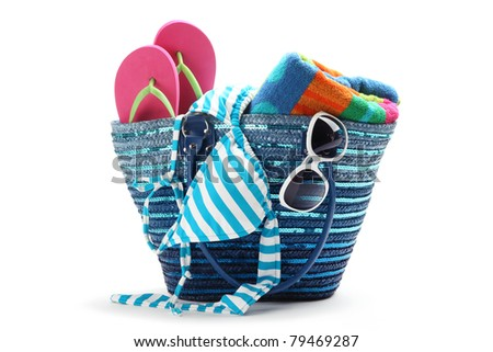 Beach bag with swimming suit,isolated on white background. - stock photo