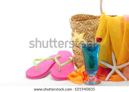 Beach bag with swimming suit on white background.