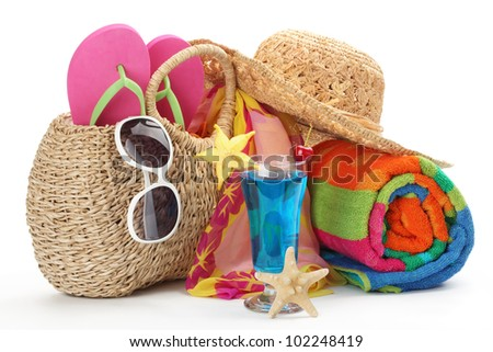 Beach bag with towel,flip flops and sunglasses. - stock photo