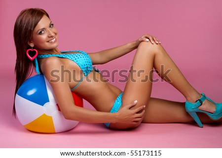 Beach ball bikini woman - stock photo
