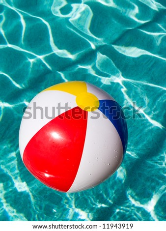 Beach Ball floating in swimming pool.
