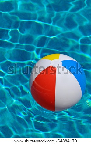 Beach Ball floating in the Swimming Pool - stock photo