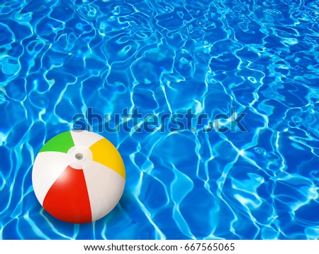Beach Ball In Water beach ball green blue pinkyellow orange stock photo 3924889