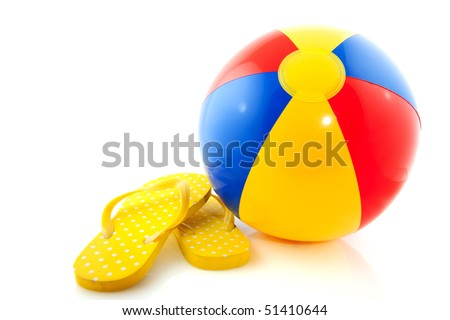 Beach ball with flip flops on white background