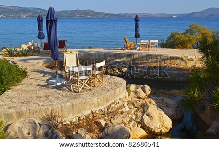 Beach bar at the sinkholes on Lassi area of Kefalonia island in Greece - stock photo