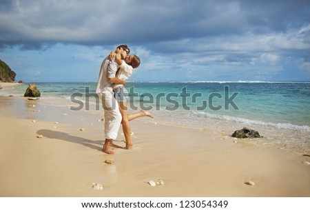 Beach, beautiful couple - stock photo