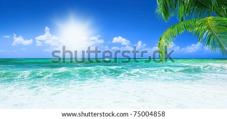 Beach, beautiful panoramic sea view, with clean water & blue sky - stock photo