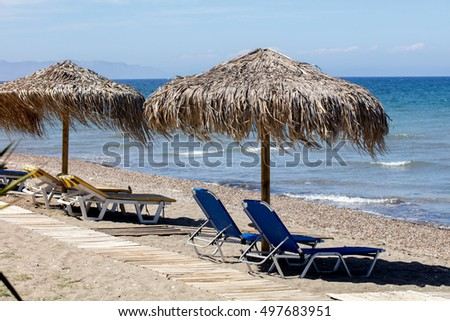 Beach bed and umbrellas
