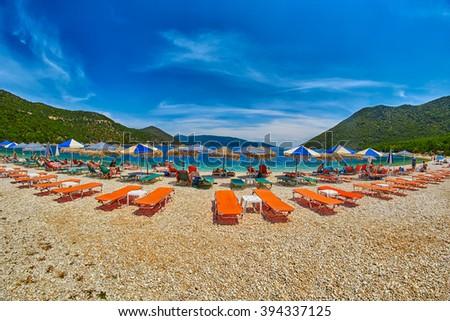 Beach Beds and Umbrellas in Antisamos Beach, Kefalonia Island, Greece - stock photo