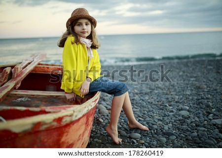 Beach, boat and girl - Portrait of lovely girl on the beach - stock photo