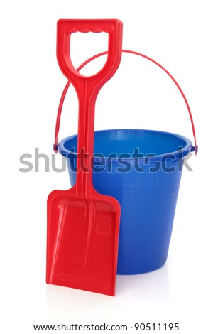 Beach bucket and spade in blue and red colours isolated over white background. - stock photo