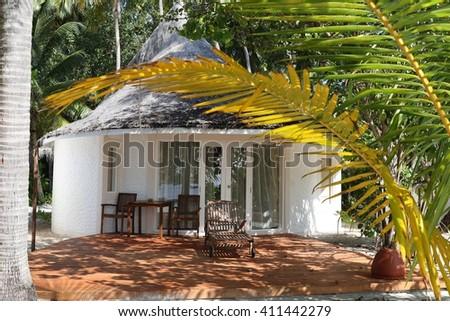 Beach bungalow, Maldives vacation background - stock photo