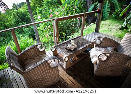 Beach bungalow terrace surrounded by jungle - stock photo