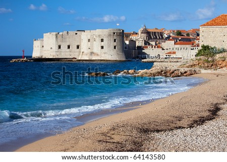 Beach by the Adriatic Sea and Old City of Dubrovnik in Croatia, South Dalmatia region.