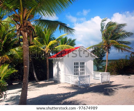 Beach cabin on a remote Caribbean island - stock photo