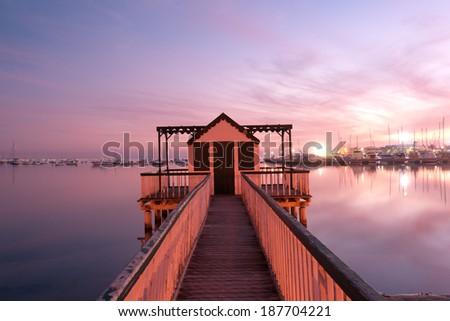 Beach cabin on San Pedro del Pinatar coast, Spain at sunset - stock photo