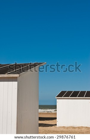 beach cabins at the belgian coast - stock photo