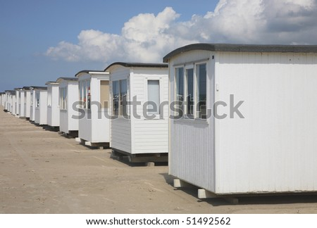 Beach cabins on the beach at Blokhus, a tourist resort in the north-western part of Jutland, Denmark.