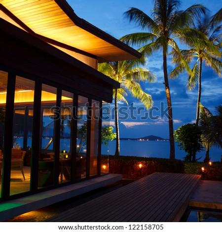 Beach cafe at sunset - stock photo