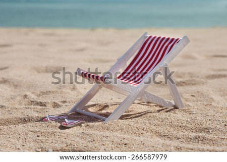 Beach Chair And Flip-flop On Sandy Beach - stock photo