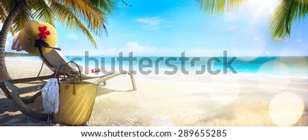 Beach chair and hat on sand beach. Concept for rest, relaxation, holidays, spa, resort. - stock photo