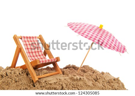 beach chair and parasol for shade at the beach - stock photo