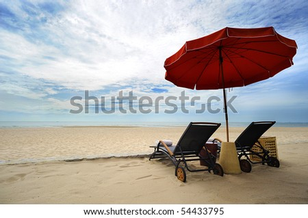 beach chair and Red Umbrella on the beach , Huahin Thailand - stock photo