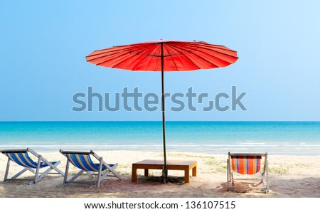 Beach chair and red umbrella on the beach ,Trat Province  Thailand