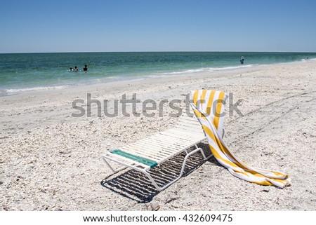 Beach Chair and Towel on Florida Coast - stock photo
