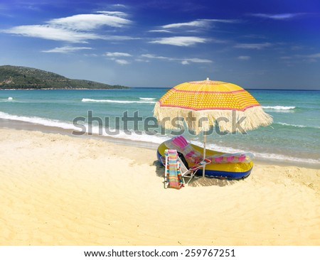 Beach chair and umbrella - stock photo