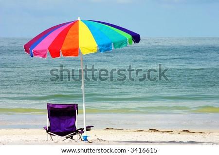 Beach chair and umbrella on Florida Gulf Coast - stock photo