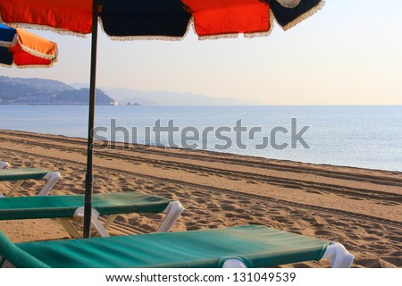 Beach chair and umbrella on idyllic tropical sand beach - stock photo