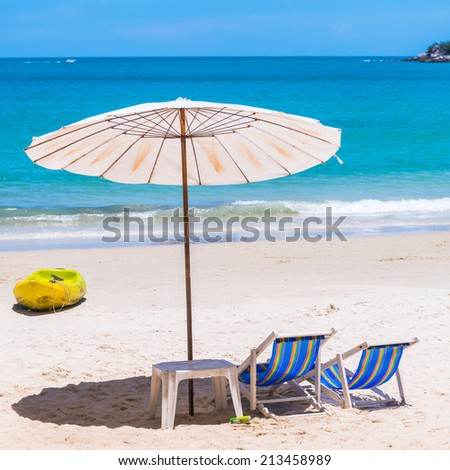 Beach chair and Umbrella on the beach at Samed Island,Thailand