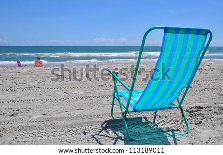 Beach Chair by the sea shore - stock photo