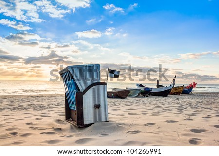 Beach chair in the morning after sunrise on Usedom - stock photo