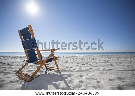 Beach Chair in the Sand at the Ocean - stock photo