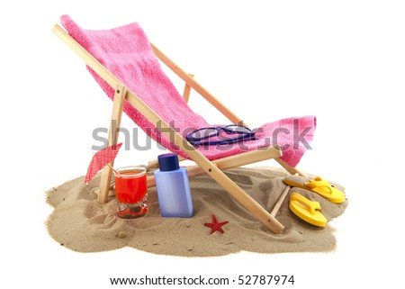 Beach chair in the sand isolated over white