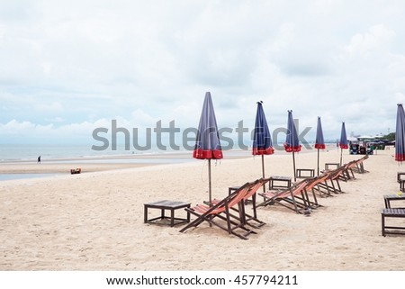 Beach chair lined on the beach sea wave background - stock photo