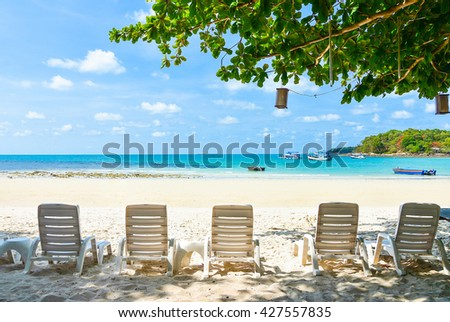 Beach chair on a beach with a view of an emerald and blue ocean. Beach chair. White beach chair. sunbath beach chair. plastic beach chair. Blue sea. Sea. White Beach. Koh Samed, Rayong, Thailand - stock photo