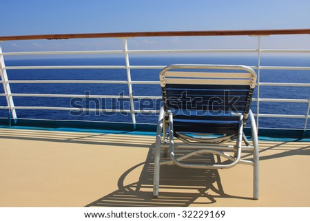 Beach chair on cruise ship deck - stock photo